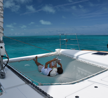 Relaxing on private catamaran day charter